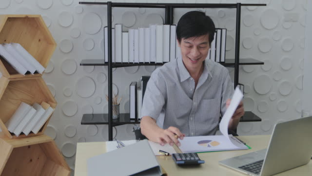senior asian men use calculators and work happy with their business goals. - achievement stock videos and b-roll footage