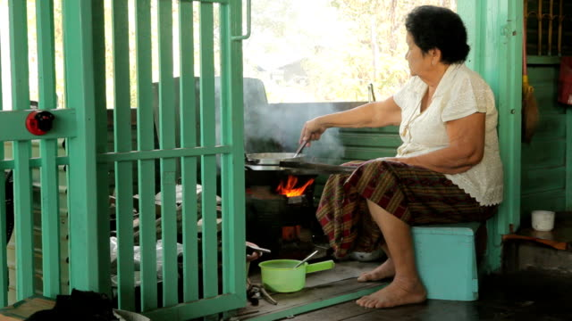 senior asian woman cooking in kitchen - stay at home mother stock videos & royalty-free footage