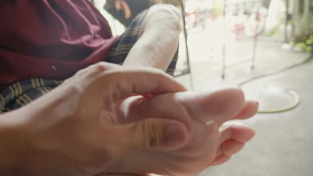 Senior Asian woman got Pain in feet finger joints , Gout