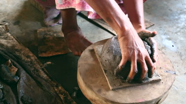 Senior Asian woman hand making a traditional pottery