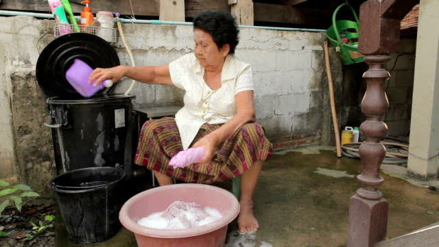 senior asian woman washing cloths by hand - cleaning product stock videos and b-roll footage