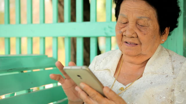 Senior asian woman  with smart phone