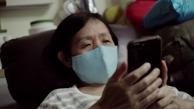 senior asian women wear protective masks covid-19. - chinese ethnicity stock videos & royalty-free footage