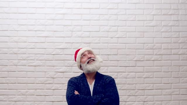 senior beard man showing copy space  in hat santa claus - santa hat stock videos & royalty-free footage