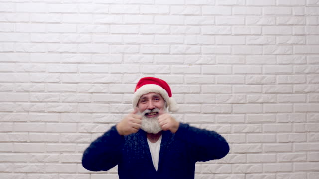 senior beard man showing copy space  in hat santa claus - party hat stock videos and b-roll footage