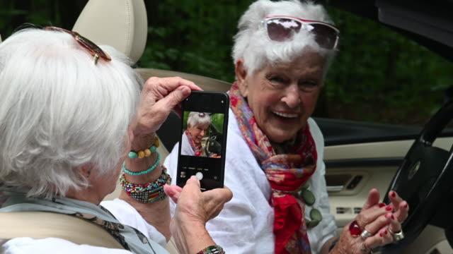 senior best women friends portrait road trip - white dress stock videos & royalty-free footage