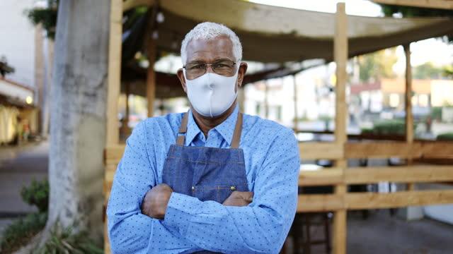 senior black business owner wearing mask - bakery stock videos & royalty-free footage