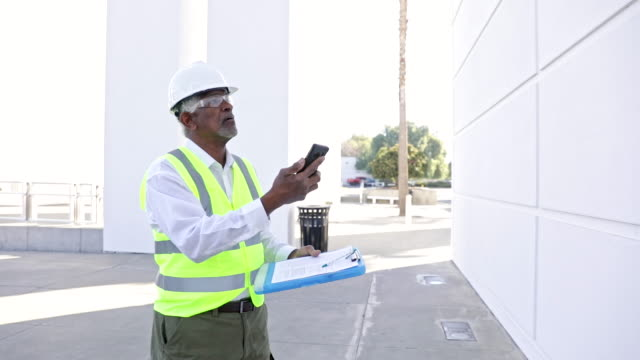 senior black man construction manager inspection - quality control stock videos & royalty-free footage