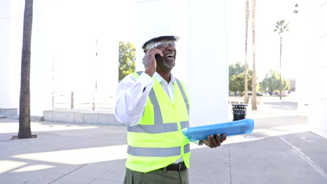 senior black man construction manager on phone call - quality control stock videos & royalty-free footage