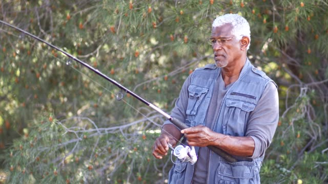 senior black man fishing - fishing industry stock videos & royalty-free footage