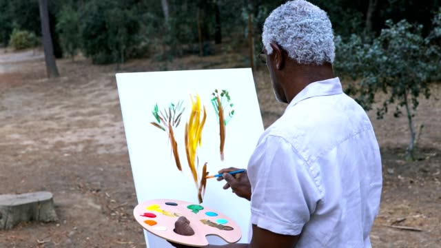 senior black man painting - young at heart stock videos & royalty-free footage