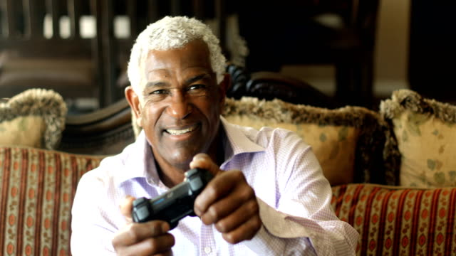 Senior Black Man Playing Video Games