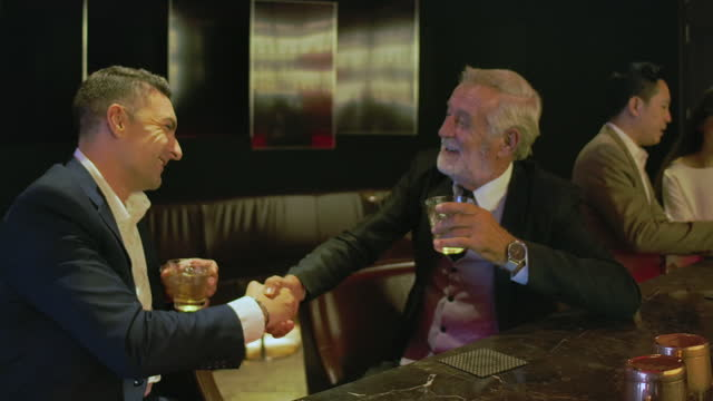 senior business man in relaxed with colleague at the bar. - colleague stock videos & royalty-free footage