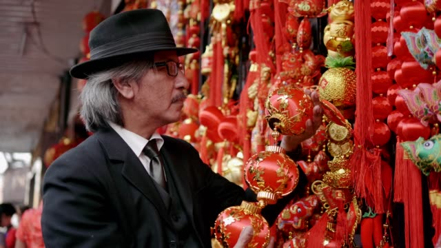 senior business men shopping chinese decorations - stock video - traditional ceremony stock videos & royalty-free footage