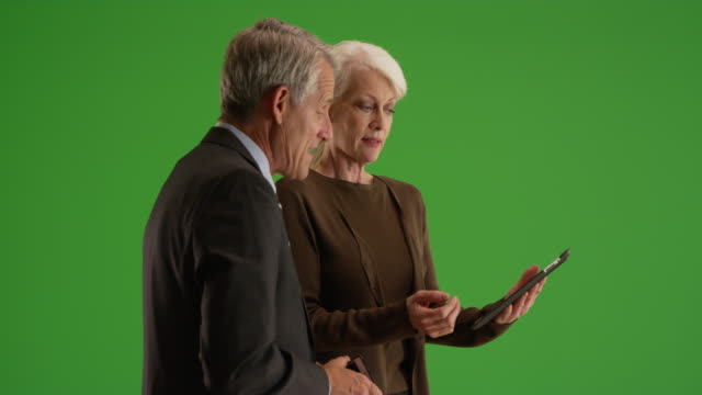 senior business team working in the office with tablet on green screen - formal businesswear stock videos & royalty-free footage