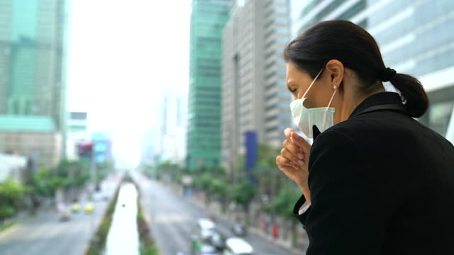 Senior Business Woman suffer from cough with face mask protection.