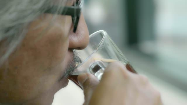 senior businessman drinking coffee - caffeine molecule stock videos & royalty-free footage