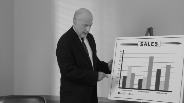 b/w ms senior businessman giving sales presentation with graph/ new york city - 1950 stock videos & royalty-free footage