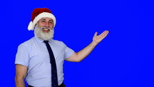 senior businessman in hat of santa claus shows up space - santa hat stock videos & royalty-free footage