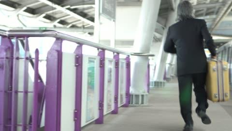 senior businessman miss the train - underground station platform stock videos & royalty-free footage
