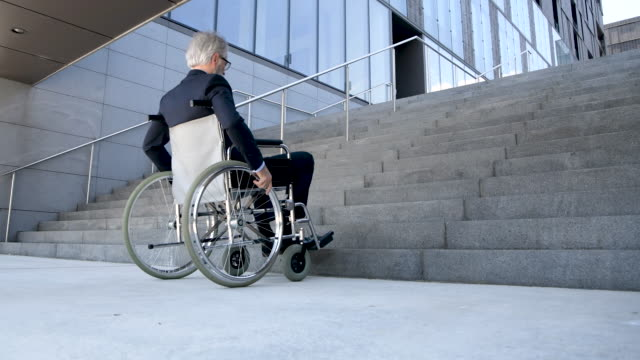 senior businessman on wheelchair - accessibility stock videos & royalty-free footage