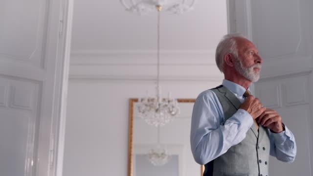 senior businessman tie his necktie - fashionable stock videos & royalty-free footage