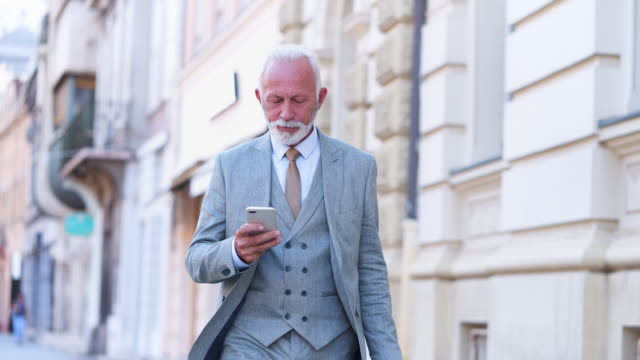 senior businessman with suitcase - grey hair stock videos and b-roll footage