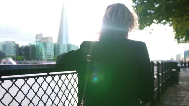 senior businesswoman using smart phone in london - gray hair stock videos & royalty-free footage