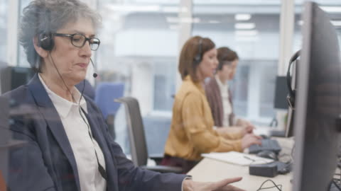 senior businesswoman working as customer support - headset stock videos & royalty-free footage