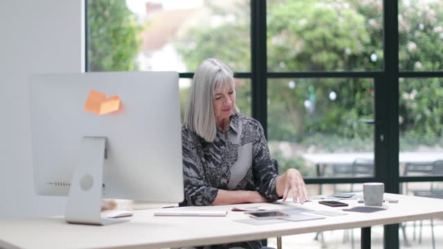 senior businesswoman working in office - kent england stock videos & royalty-free footage
