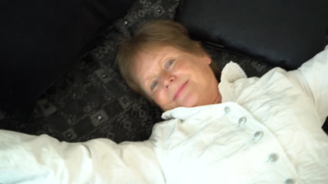 senior caucasian woman laying on bed - 70 79 years stock videos and b-roll footage