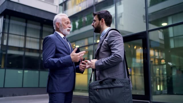 senior ceo giving advices to his apprentice about how to improve his project and income - critic stock videos & royalty-free footage