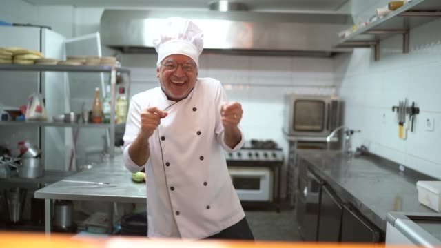 senior chef dancing at kitchen - kitchen stock videos & royalty-free footage