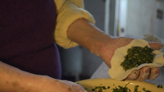 Senior Chinese woman preparing traditional food