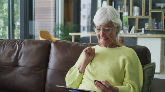 senior citizen discount! yes! - electronic banking stock videos & royalty-free footage