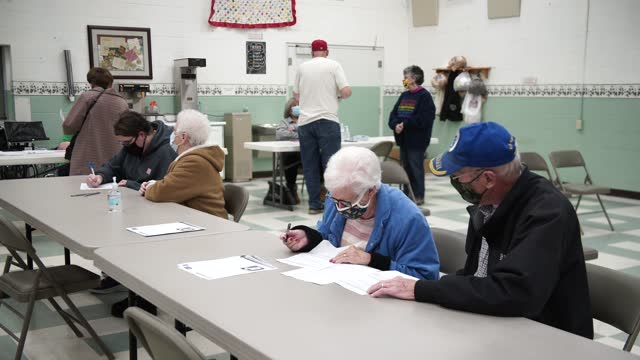 senior citizens fill out paperwork at the hansford senior center in st. albans, west virginia on february 12, 2021. familycare health centers... - health and safety stock videos & royalty-free footage
