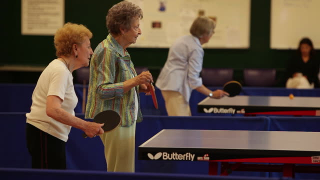 """""""ms senior citizens playing ping pong / laguna woods, ca, united states """" - only senior women stock videos & royalty-free footage"""