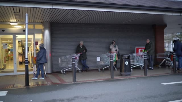 senior citizens queue to shop at sainsbury's supermarket on march 19 2020 in northwich united kingdom a queue of approximately 600 old age pensioners... - corona stock-videos und b-roll-filmmaterial