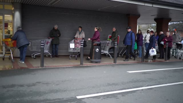 senior citizens queue to shop at sainsbury's supermarket on march 19, 2020 in northwich, united kingdom. a queue of approximately 600 old age... - queuing stock videos & royalty-free footage