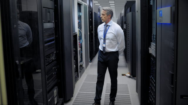 ld senior computer engineer checking servers in the server room - network server stock videos & royalty-free footage