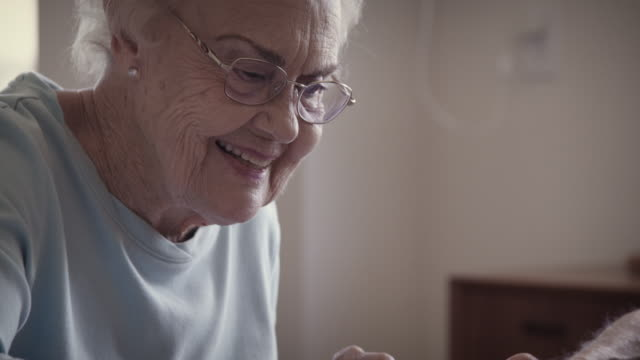 senior couple and a puzzle - puzzle stock videos & royalty-free footage