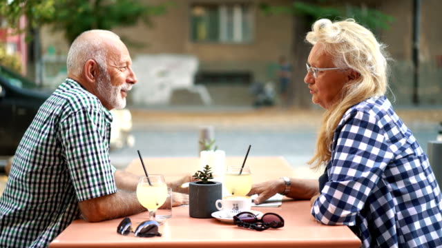 senior couple at a sidewalk cafe. - pavement cafe stock videos & royalty-free footage