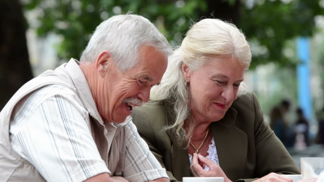 senior couple at cafe - leisure activity stock videos & royalty-free footage