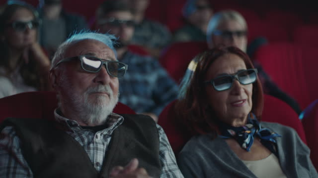 senior couple at cinema - 3d glasses stock videos & royalty-free footage