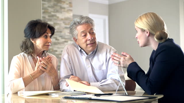 senior couple at home talking to financial planner - advice stock videos and b-roll footage
