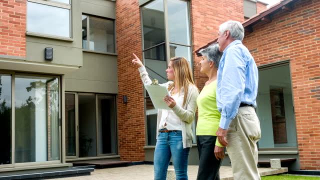 Senior couple buying a house