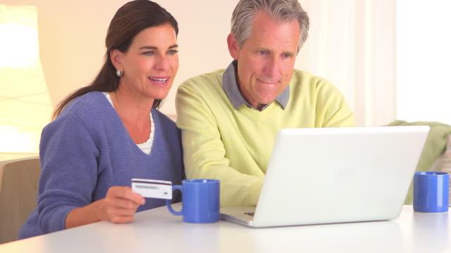 Senior couple buying getaway vacation