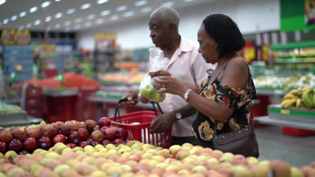 senior couple buying on supermarket - supermarket stock videos & royalty-free footage