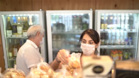 senior couple buying with face mask at store - lockdown stock videos & royalty-free footage