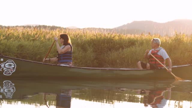 senior couple canoeing at dusk - idaho stock videos & royalty-free footage